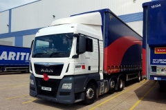 Bibby MAN cab with curtainsider trailer bearing remembrance Poppy