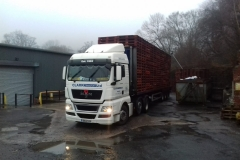 Clark Transport Ltd MAN Flatbed Trailer loaded with pallets