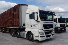 Clark Transport Ltd MAN loaded with pallets on flatbed trailer