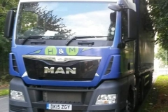 H & M MAN truck with curtainsider trailer