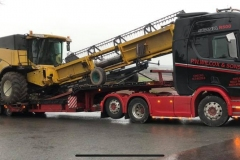 P W Wilcox and Sons Scania R500 loaded with a Combine Harvester
