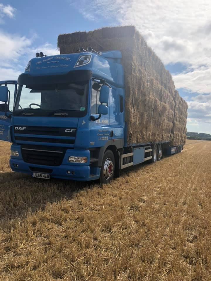 Phil Morris Transport DAF CF Rigid Truck with a trailer loaded with bales