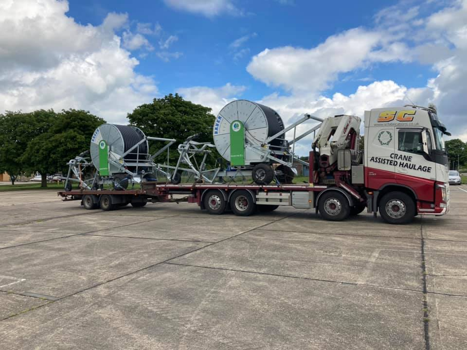 SC-Crane-assisted-Haulage-Volvo-rigid-flatbed-with-trailer-loaded-with-cable-reels