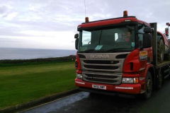 Scania R410 Rigid low loader loaded with a Construction vehicle