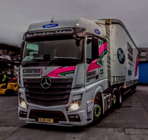 Courier Connections Mercedes Actros with lights on