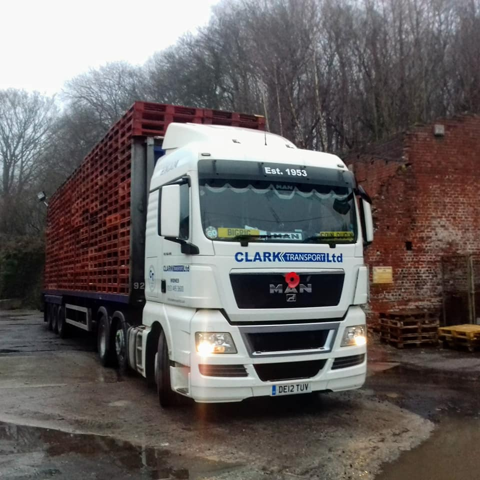Clark Transport Ltd MAN with flatbed trailer carrying pallets