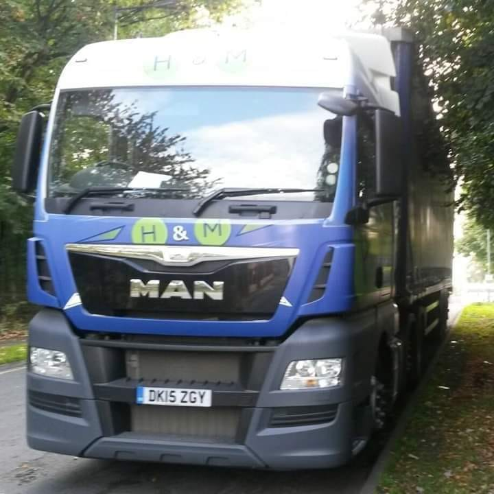 H&M MAN with curtainsider trailer