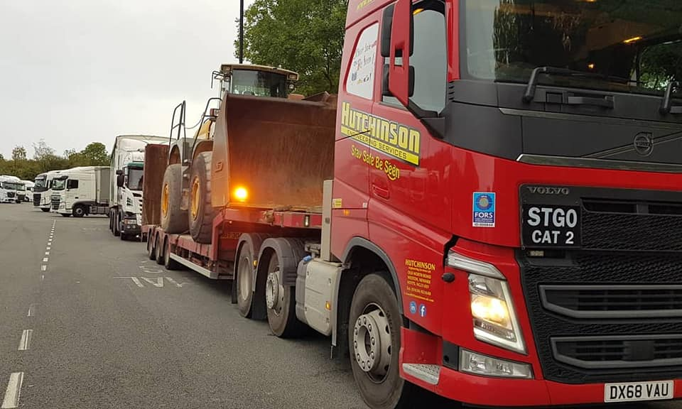Hutchinson Engineering Services Volvo FH low loader with loading shovel on trailer