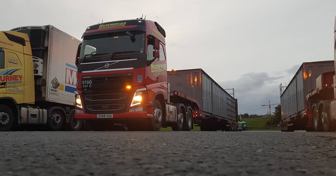 Hutchinson Volvo FH with heavy haulage low loader trailer