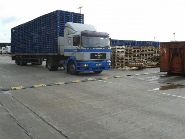 MAN truck flatbed trailer loaded with pallets
