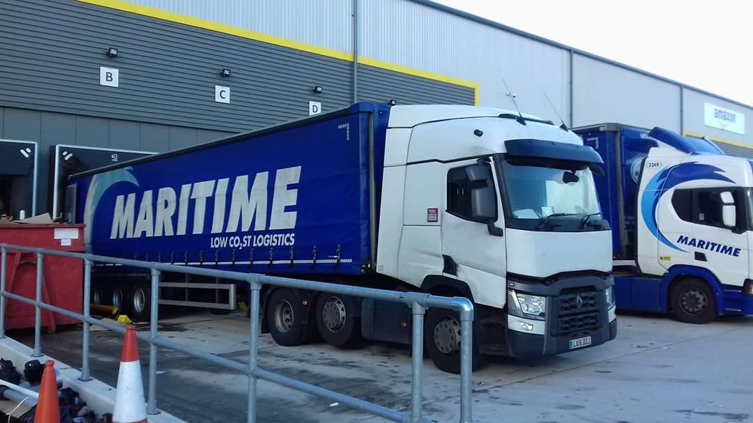 Maritime Logistics Renault tractor unit with curtainsider trailer