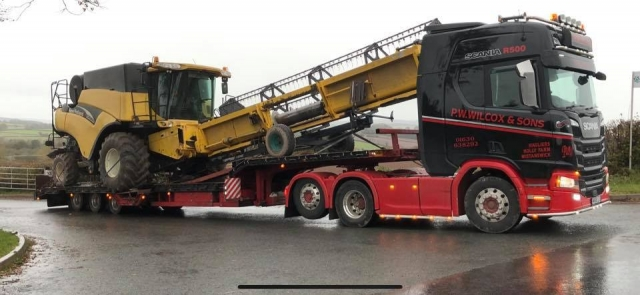 P W Wilcox and Sons Scania R500 loaded with Combine Harvester