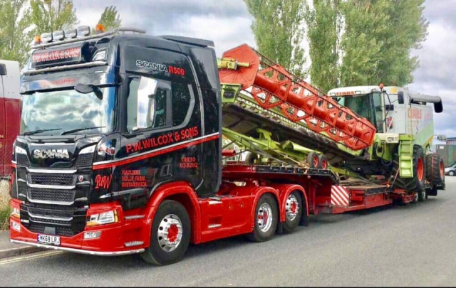 P W Wilcox & sons Scania R500 with low loader carrying combine harvester