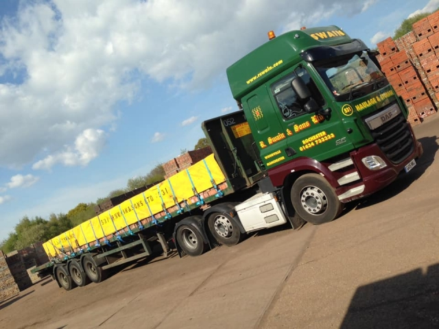 R Swain and Sons DAF CF with flatbed trailer loaded with bricks
