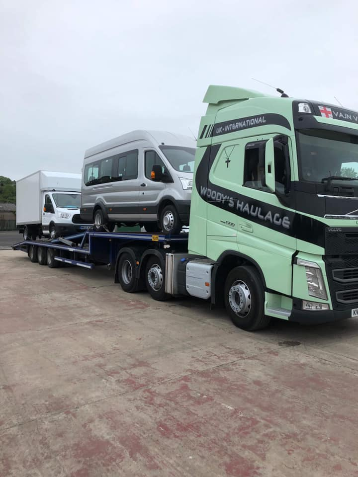 Woody's Haulage Volvo truck with low loader carrying vehicles